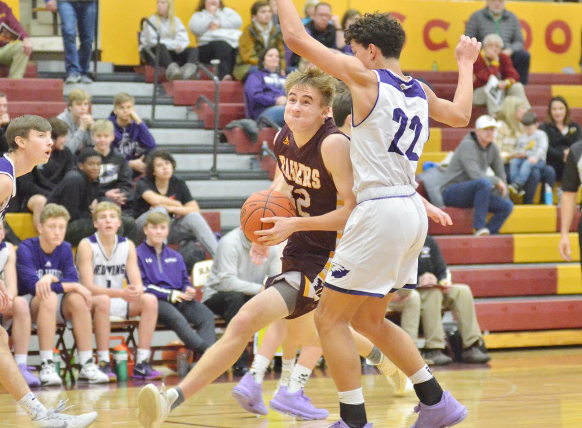 Inside work from guards and forwards alike lift Raider boys basketball past Wingers