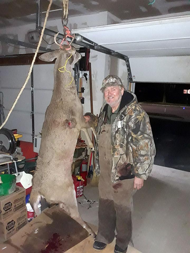 Pastor Dave with deer.jpg