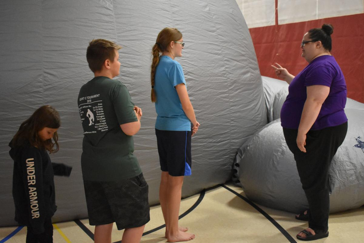 Out of this world: Library's planetarium event draws 140+ attendees
