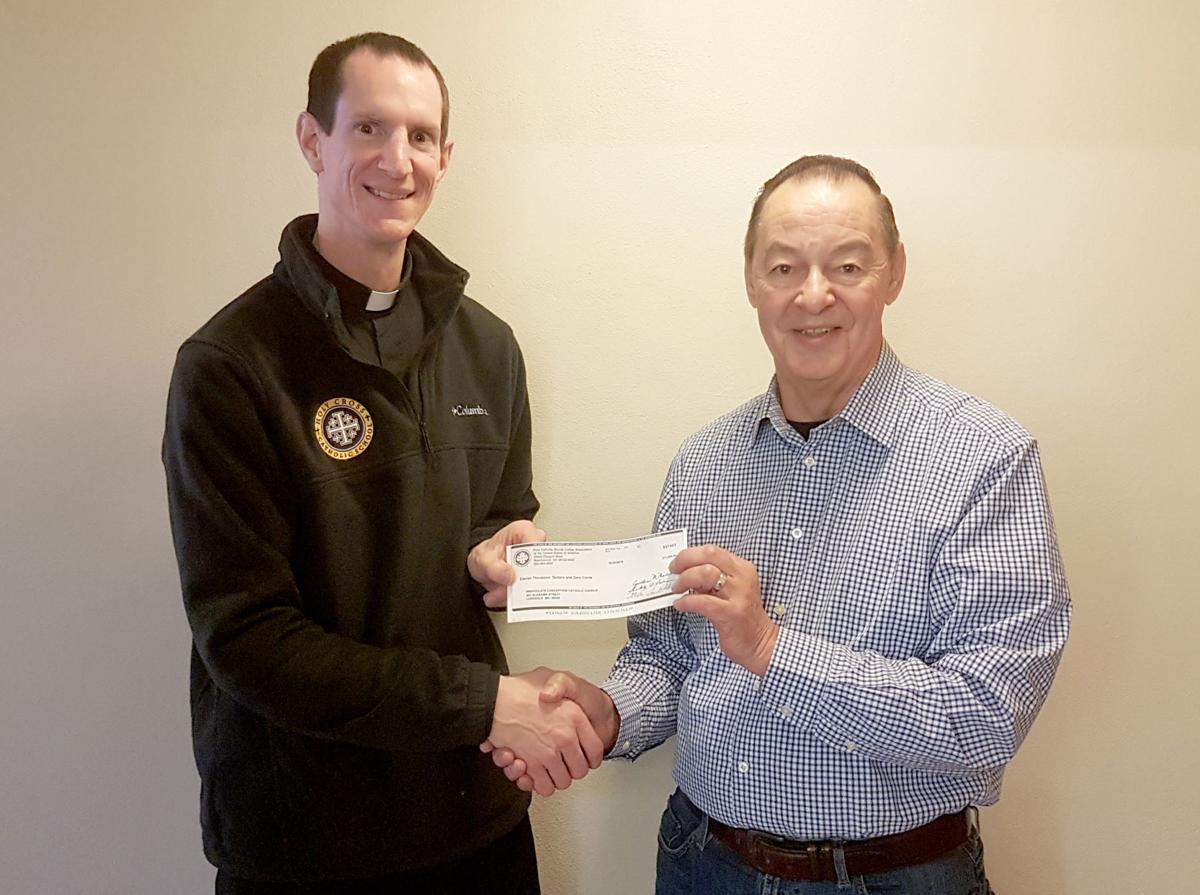 FCSLA presents check to Lonsdale Church