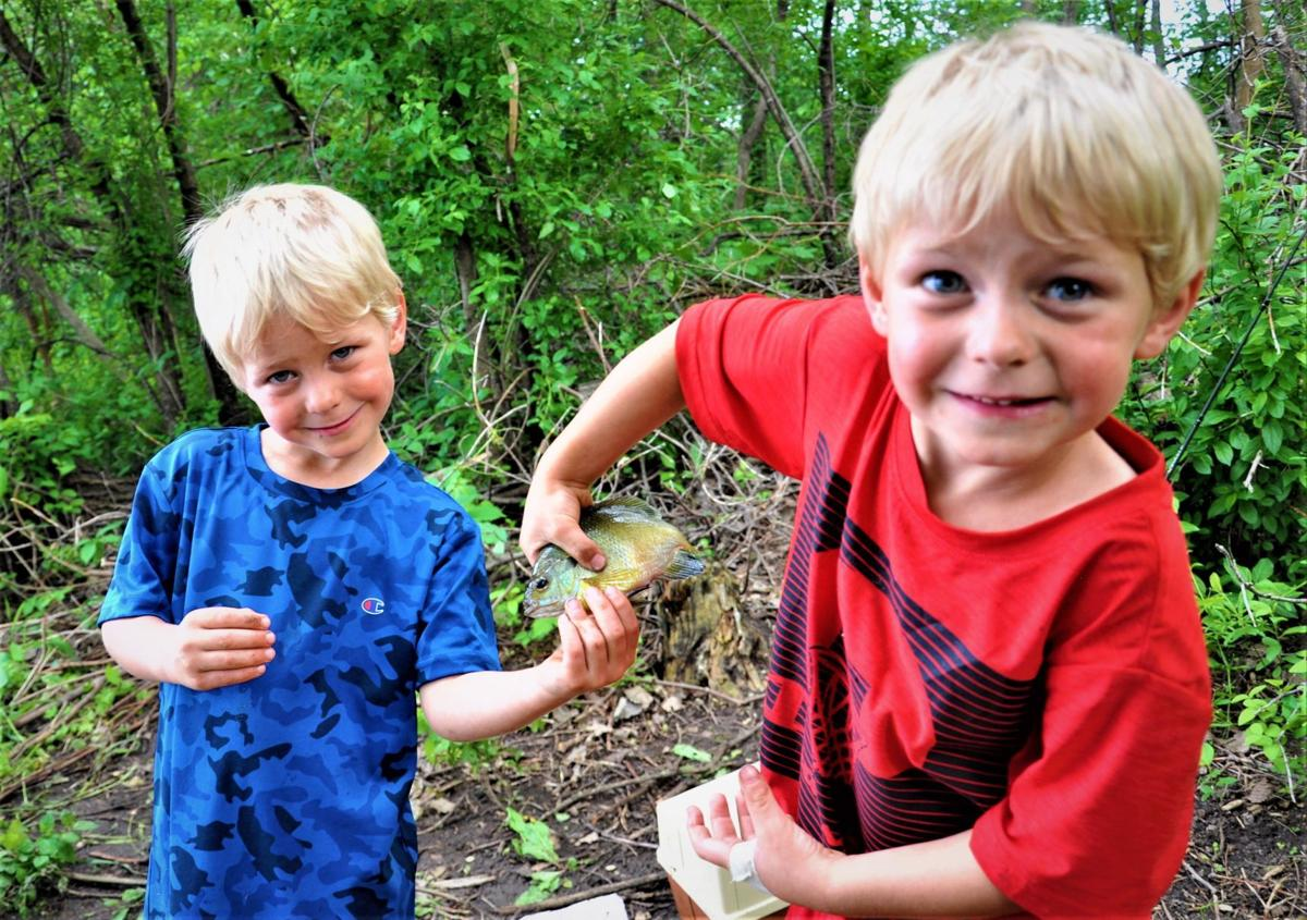Keating twins hold fish (2).jpg