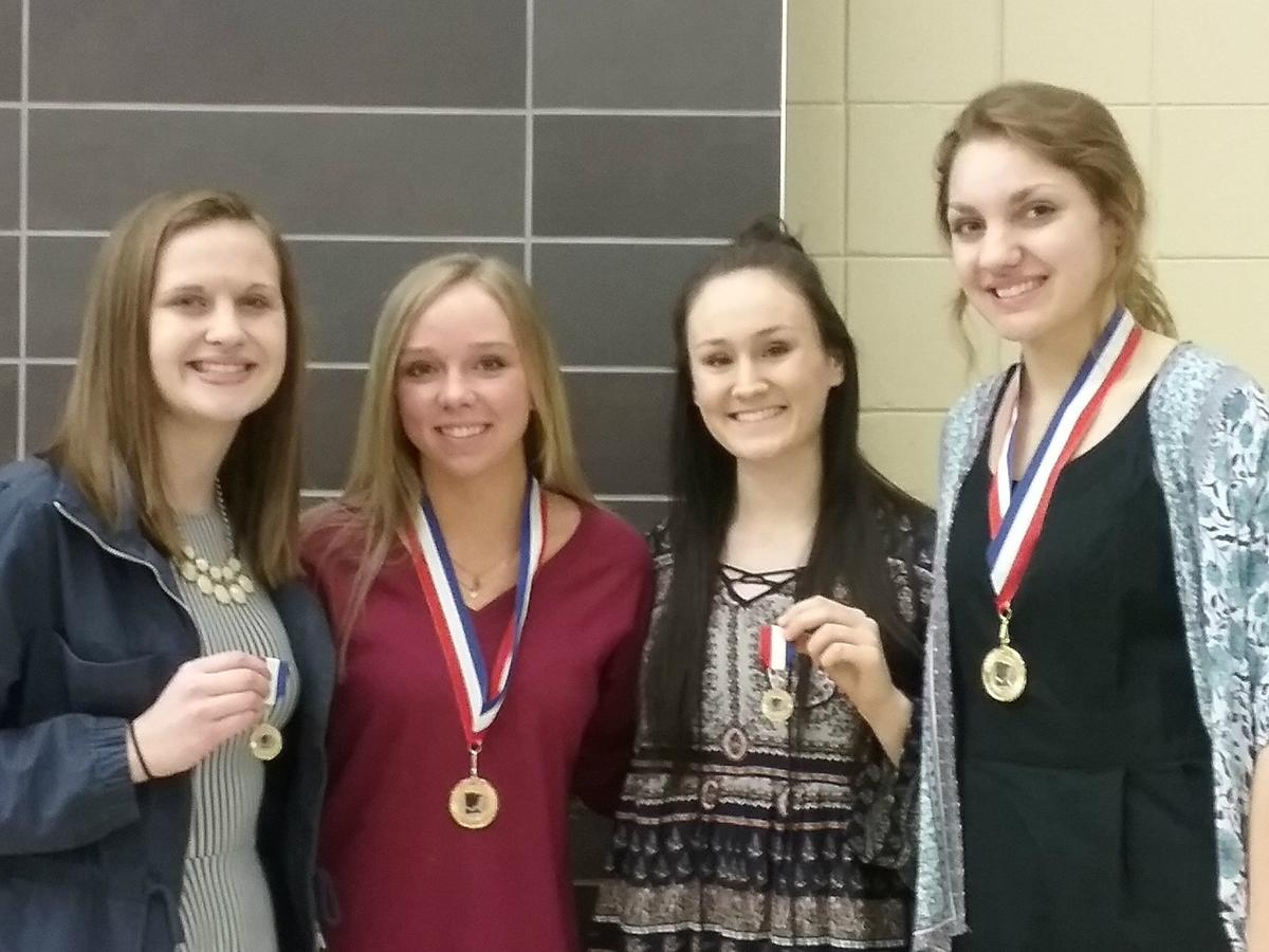 Four girls' basketball players gain conference honors