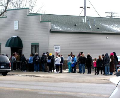 Line outside of Kenyon PD's 'Garage of Goodness'
