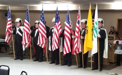 Fourth Degree Knights of Columbus Honor Guard present flags at