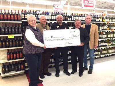 Cashwise Liquor makes a gift to the Owatonna Foundation