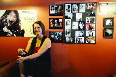 Artist Tracy Frederick in front of her work