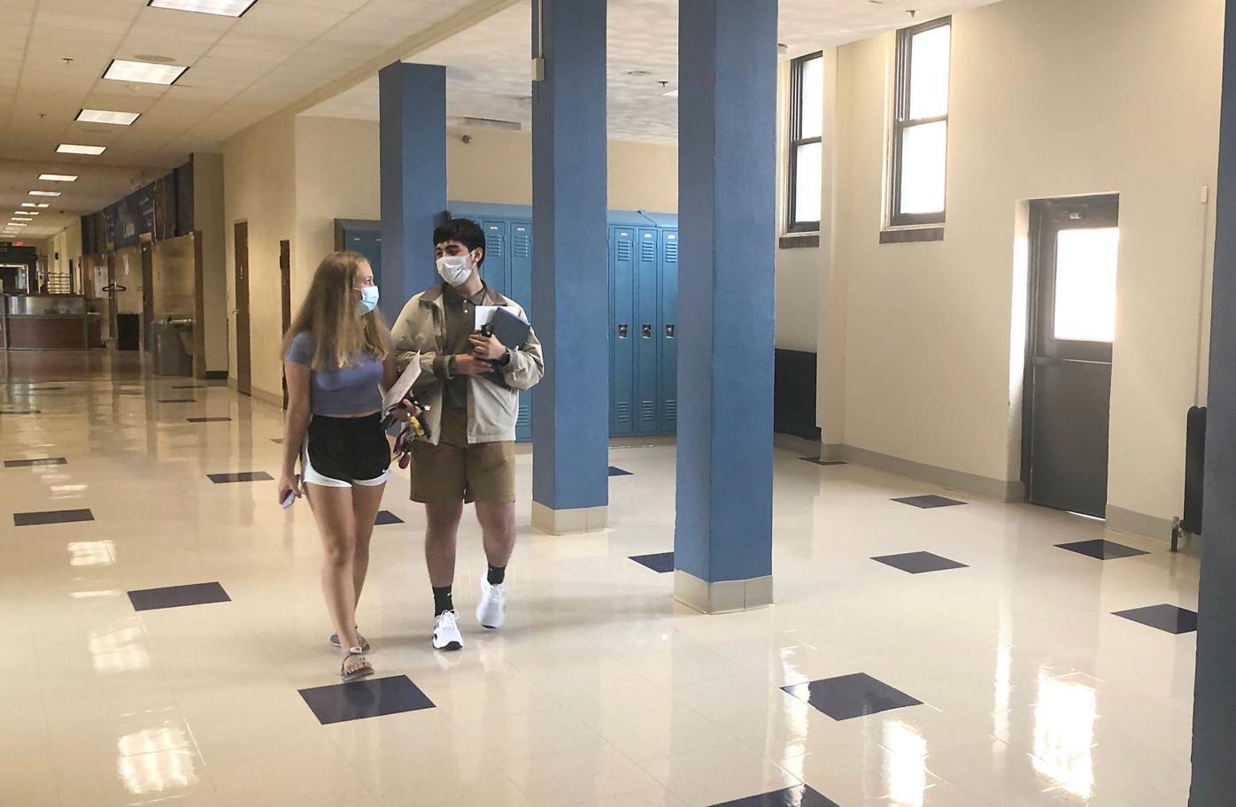Owatonna High School hall with masks