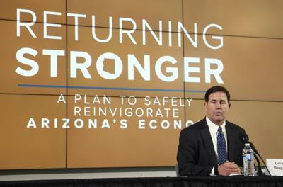 Virus Outbreak Arizona Governor Turnabout