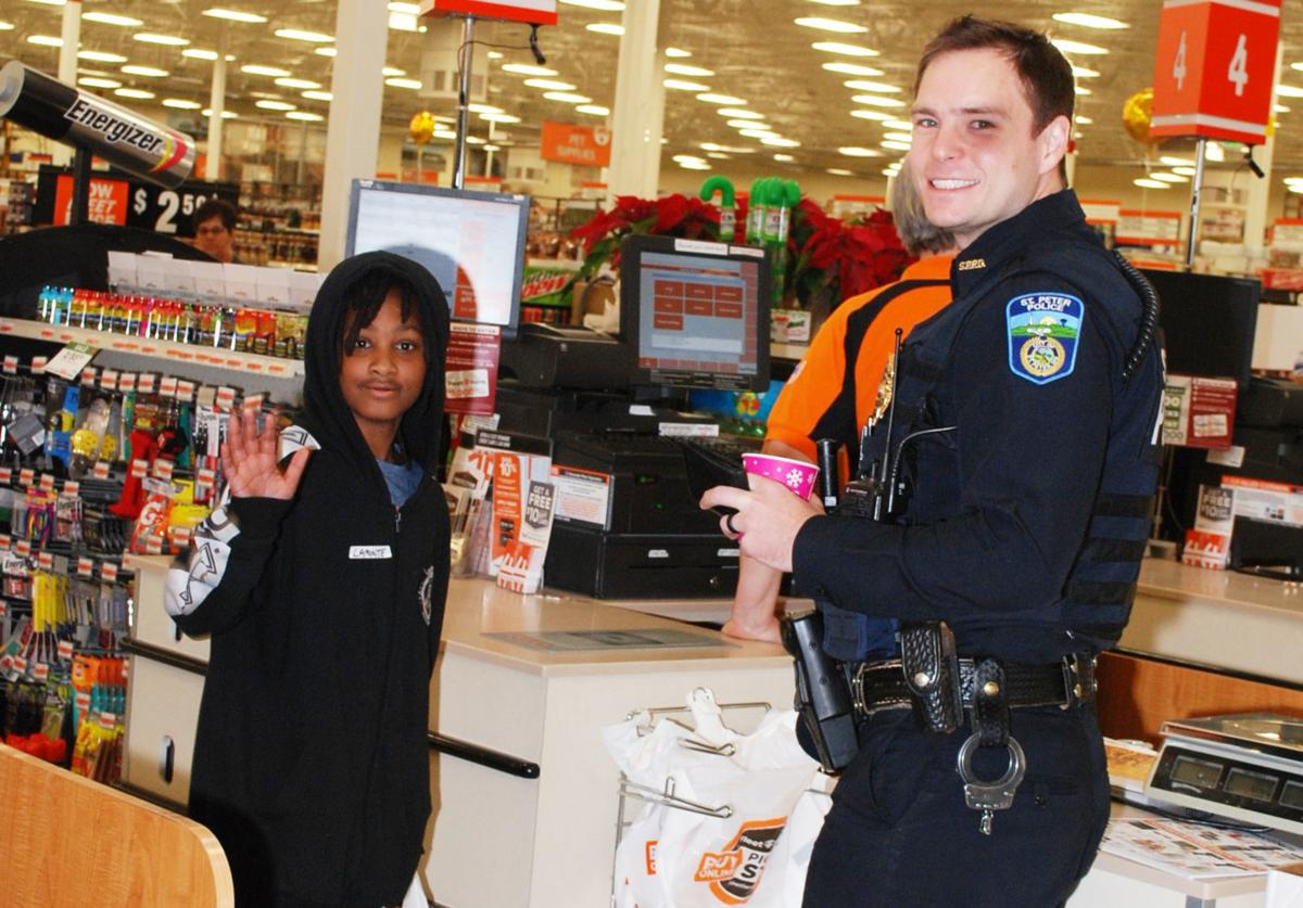 Local officers and firefighters help kids get presents for holidays