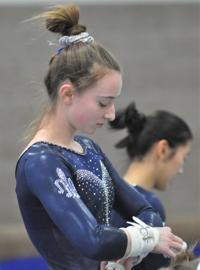 Saints gymnasts defeat Blue Earth Area