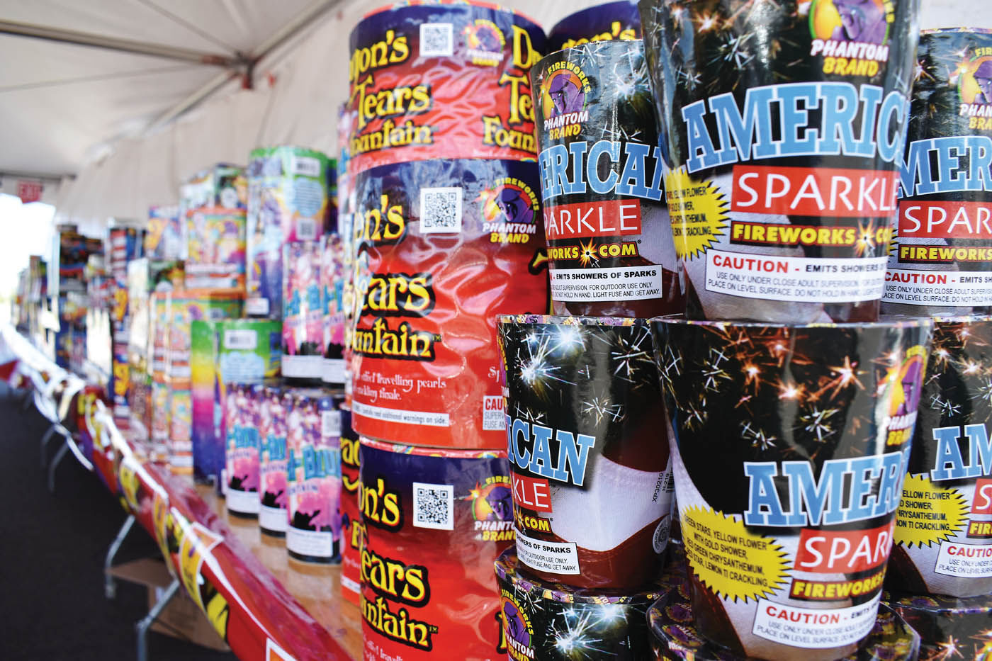 Fountains line tables at Phantom Fireworks located in the parking lot of Ultra Outlets of Medford Monday. The tent will be up through July 4. & Phantom Fireworks opens at Ultra Outlets of Medford | News ...