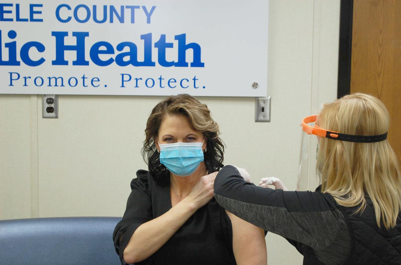 Amy Caron receives COVID-19 vaccine