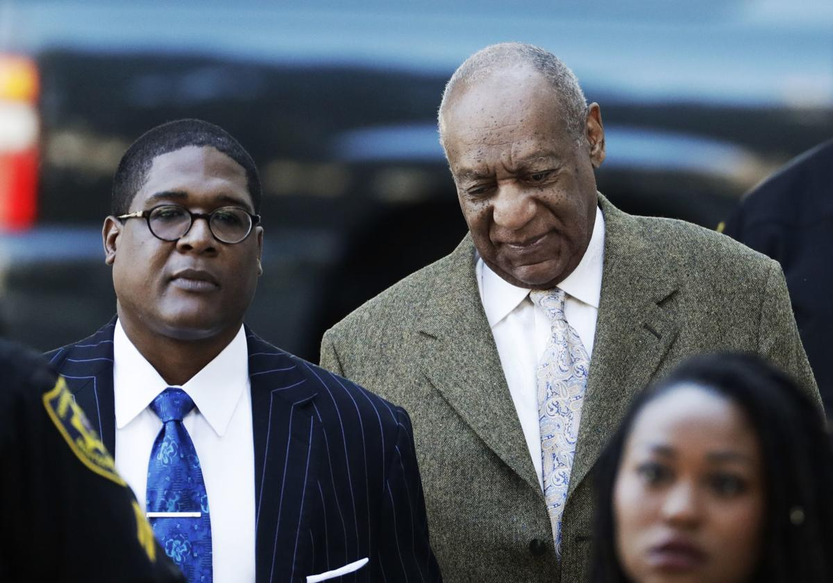 Bill Cosby arrives with spokesman, Andrew Wyatt, left, for a pretrial  hearing in his sexual assault case at the Montgomery County Courthouse, ...