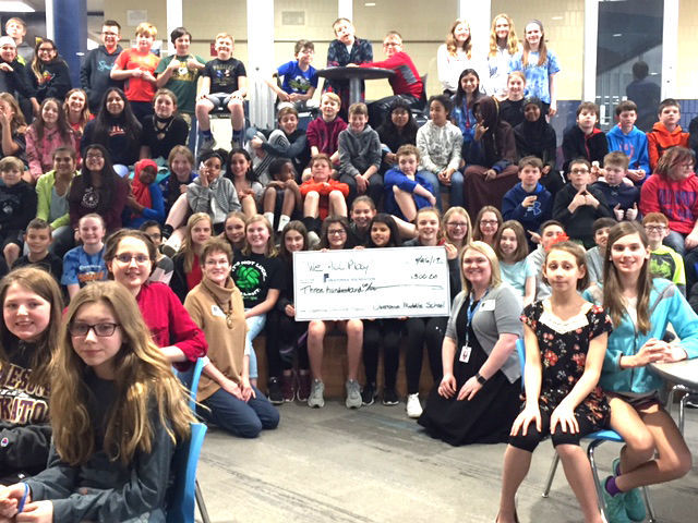 """Owatonna Foundation Helps Owatonna Middle School students make donations to the Steele County Food Shelf and """"We All Play"""" Project"""
