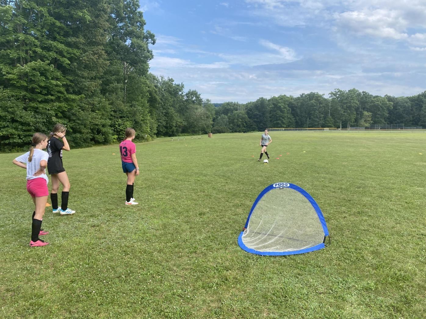 Cougar FC practices with pop-up net
