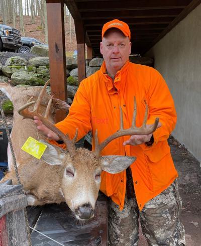 Jeff Dutzer shows 10-point buck he took near Hazleton