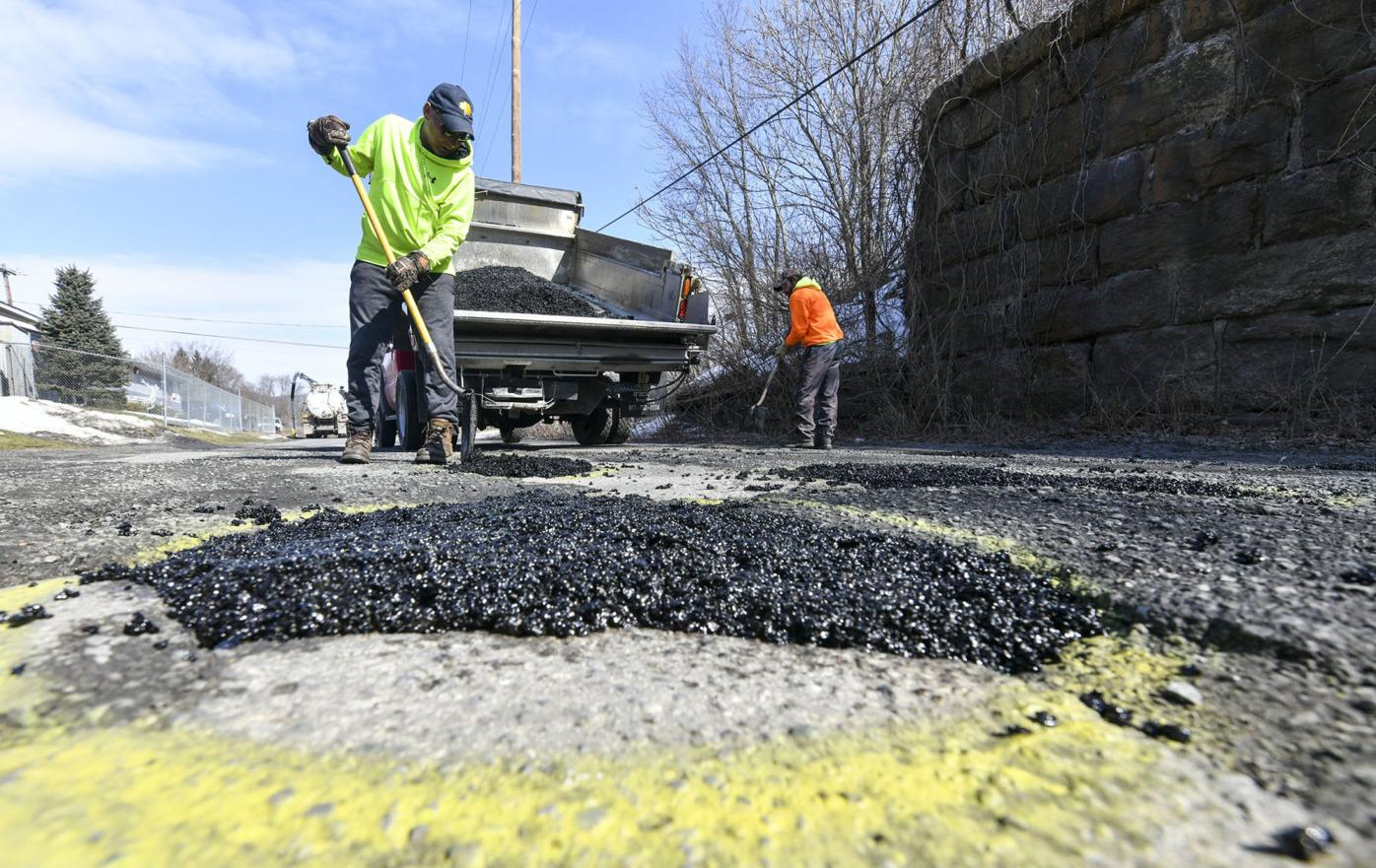 In the road again: potholes spring up