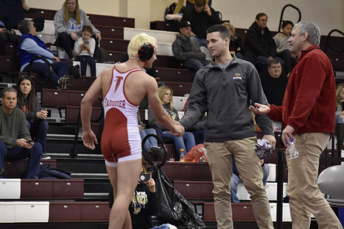 Hoffman head wrestling coach in Virginia