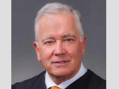 Chief judge halts all federal court trials in region