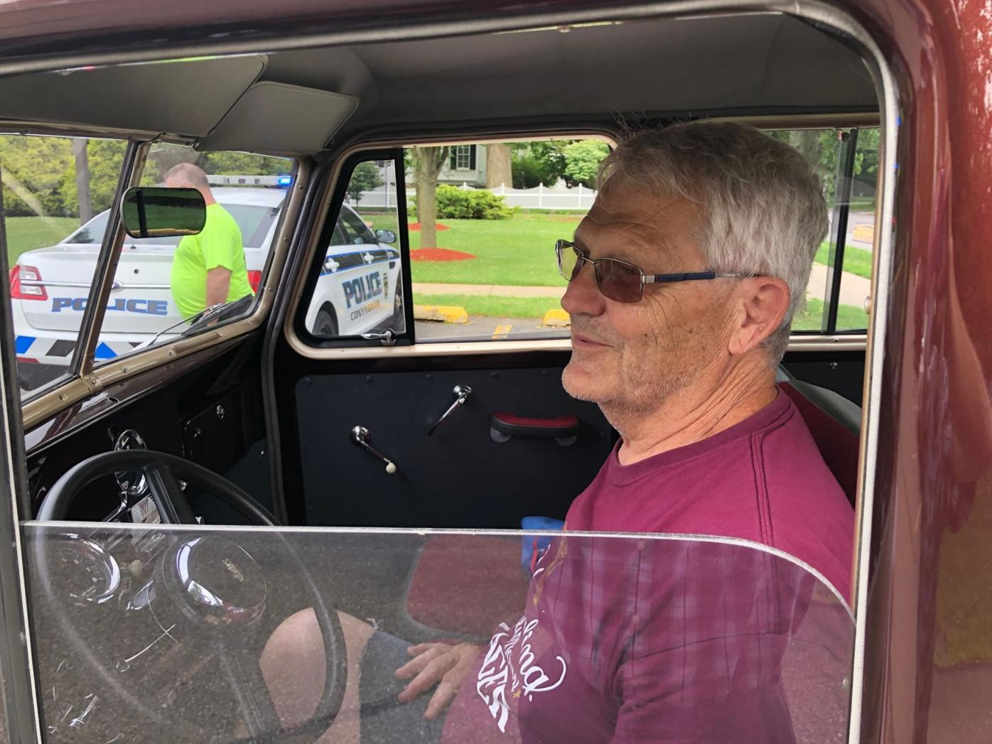 Fred Coleman at the wheel of his Willys station wagon