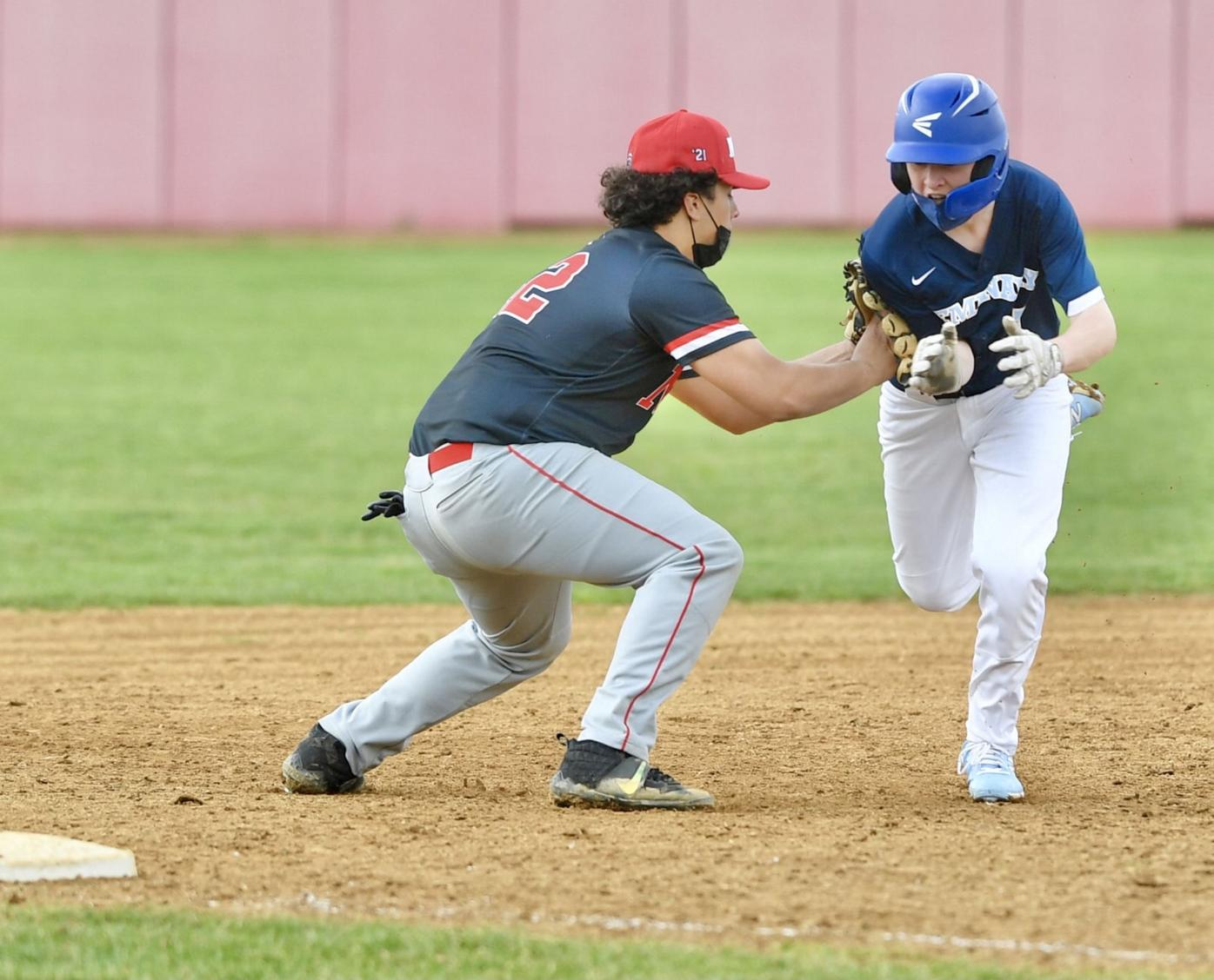 Cougars stay perfect, edge Emmaus