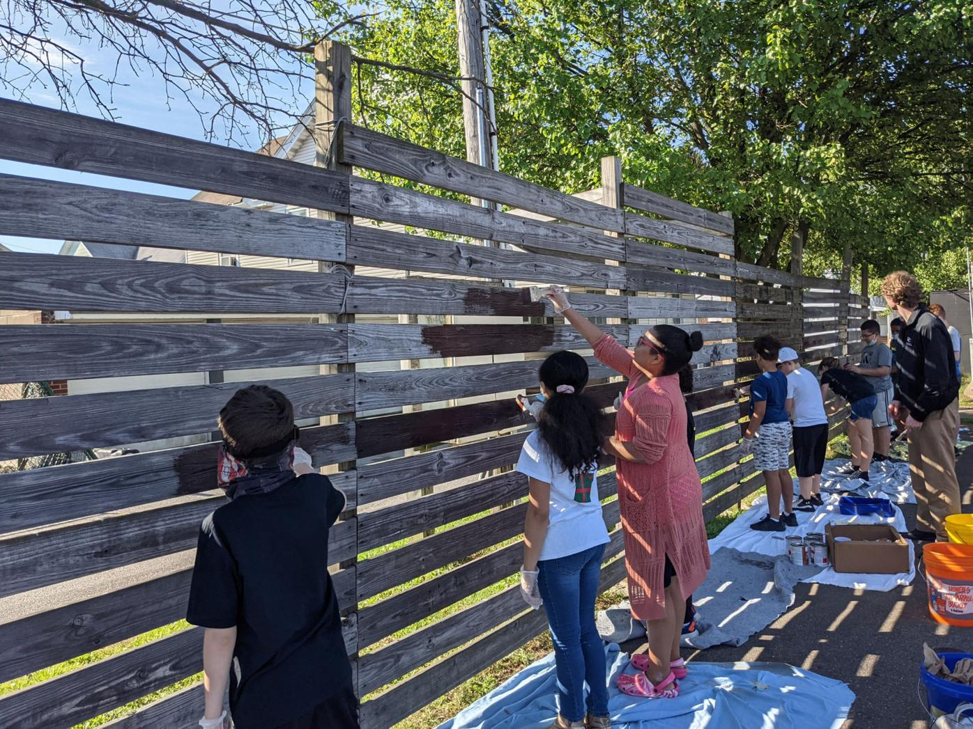 5th_and_6th_graders_paint_the_fence_on_the_basketball_court