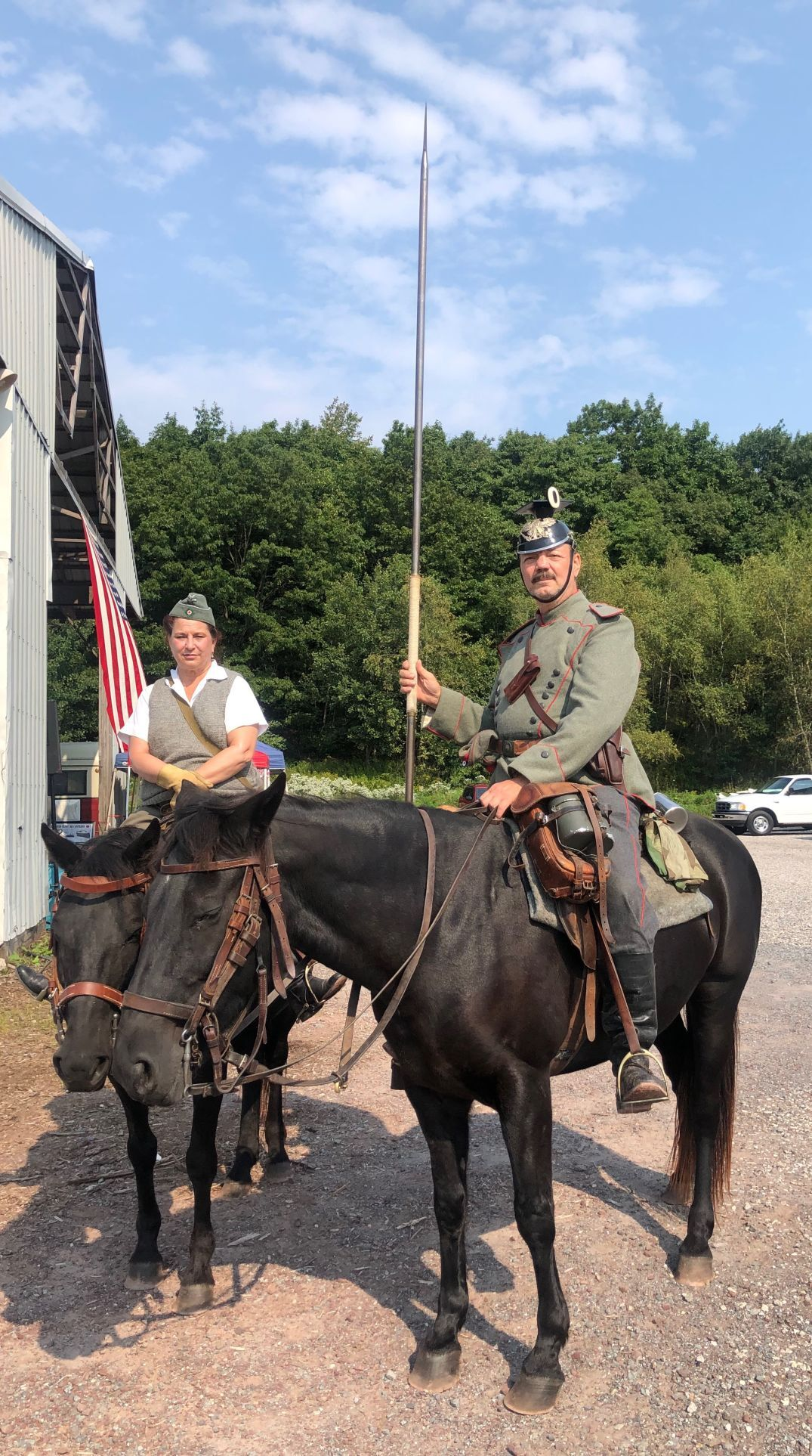 Riders show horses at WWII re-enactment