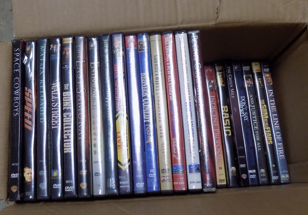 100 DVD ass't. movies in ex. cond. CASH ONLY