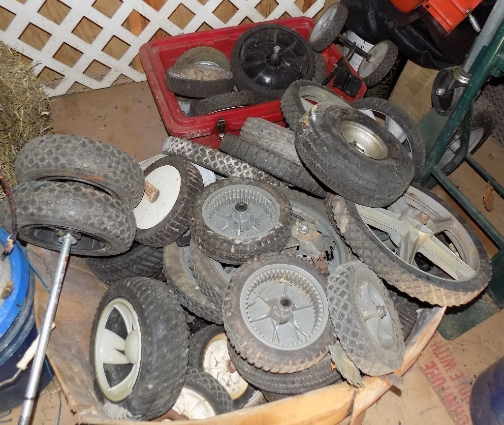 2 Large Boxes of Lawn Mower Wheels in EX. Cond. CASH ONLY.