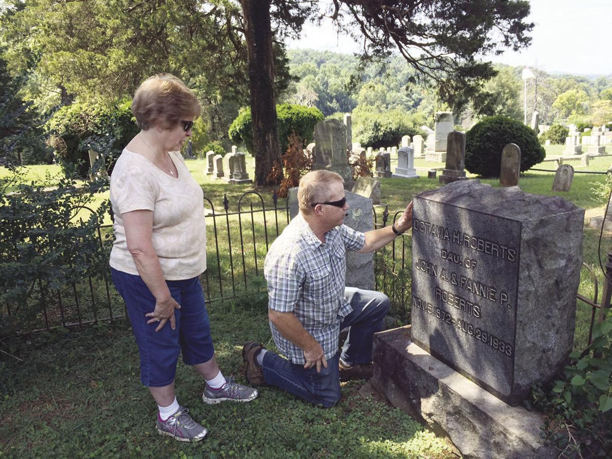 HH-5 Graham Cem trustees Mike and May Saxton inspect a gravestone.jpg