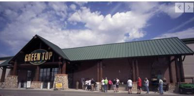 Customers lined up outside the Green Top Sporting Goods store in Hanover. (copy)