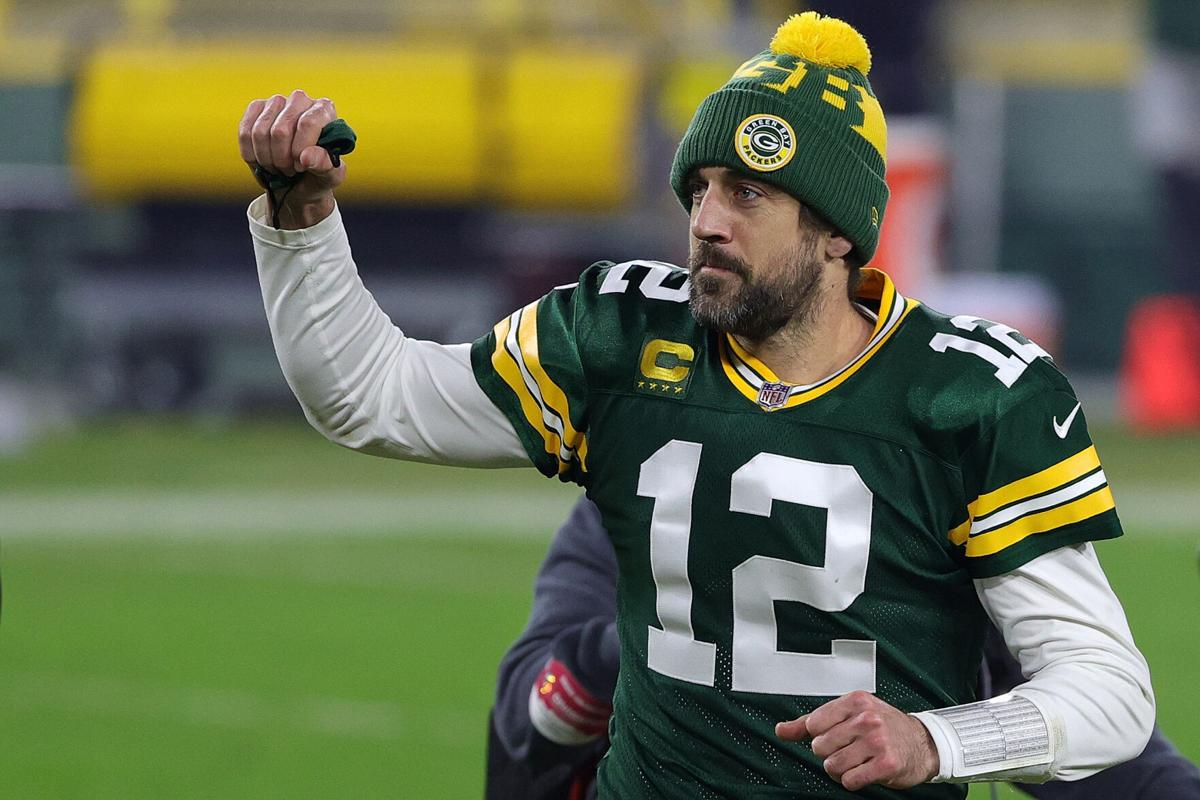 Aaron Rodgers #12 of the Green Bay Packers leaves the field following the NFC Divisional Playoff game against the Los Angeles Rams at Lambeau Field on Jan. 16, 2021 in Green Bay, Wisconsin.