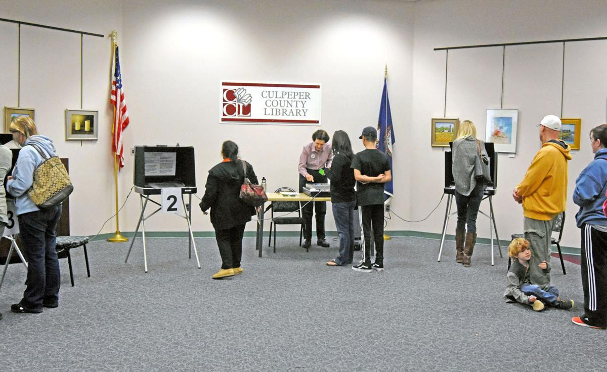 Residents of the east fairfax magisterial district vote last year on touch screen machines at the culpeper county library