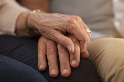 Senior couple holding hands (copy)