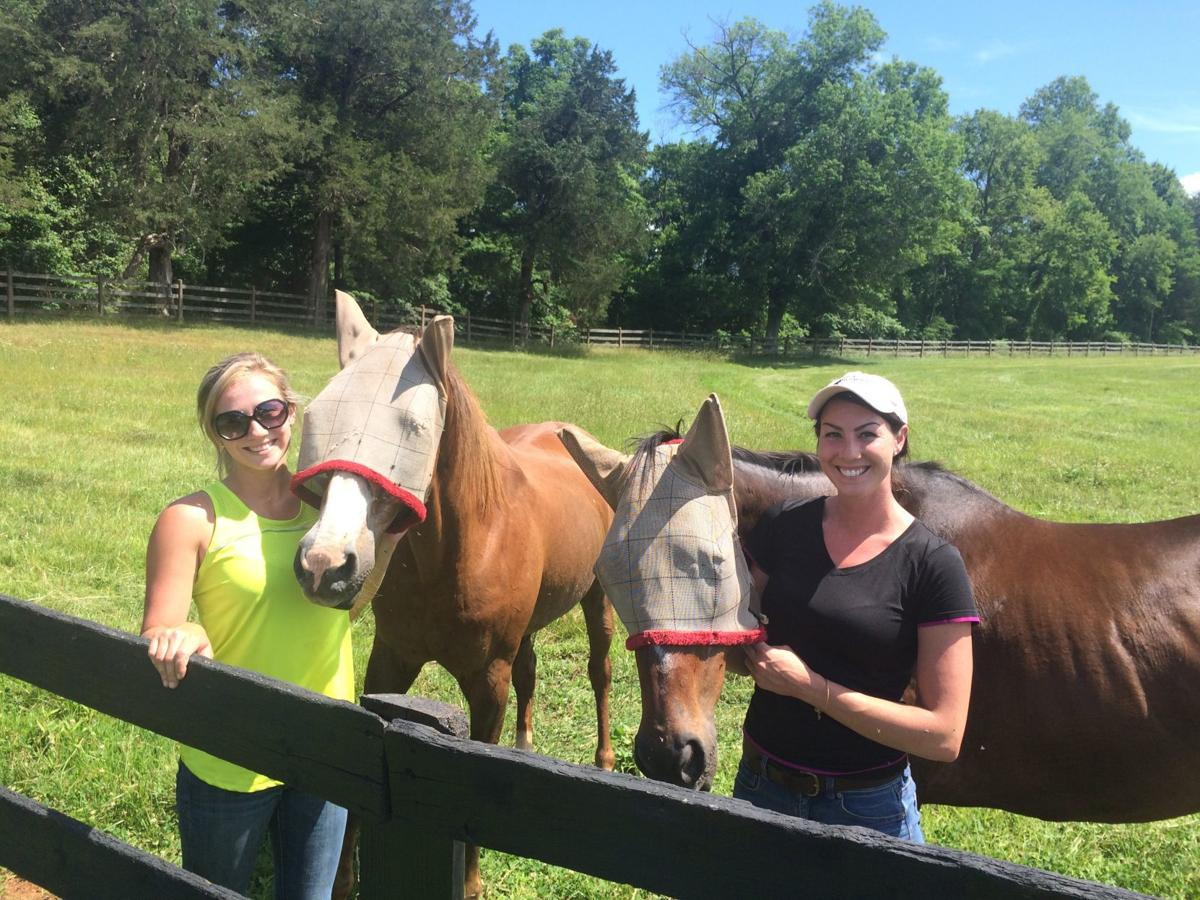 Farm managers pose with TRF horses at Montpelier