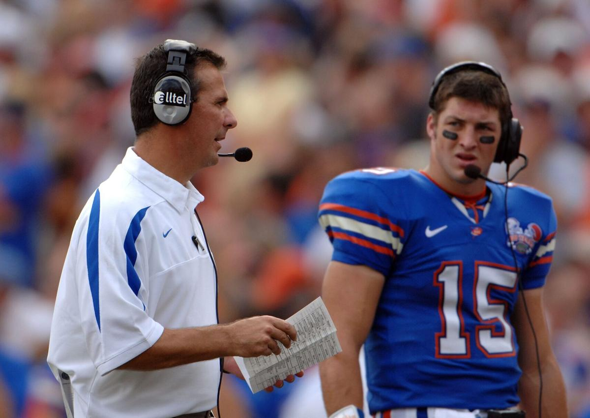 Then Gators Head Coach Urban Meyer and Tim Tebow are shown on Oct. 7, 2006 at Ben Hill Griffin Stadium in Gainesville, Florida.