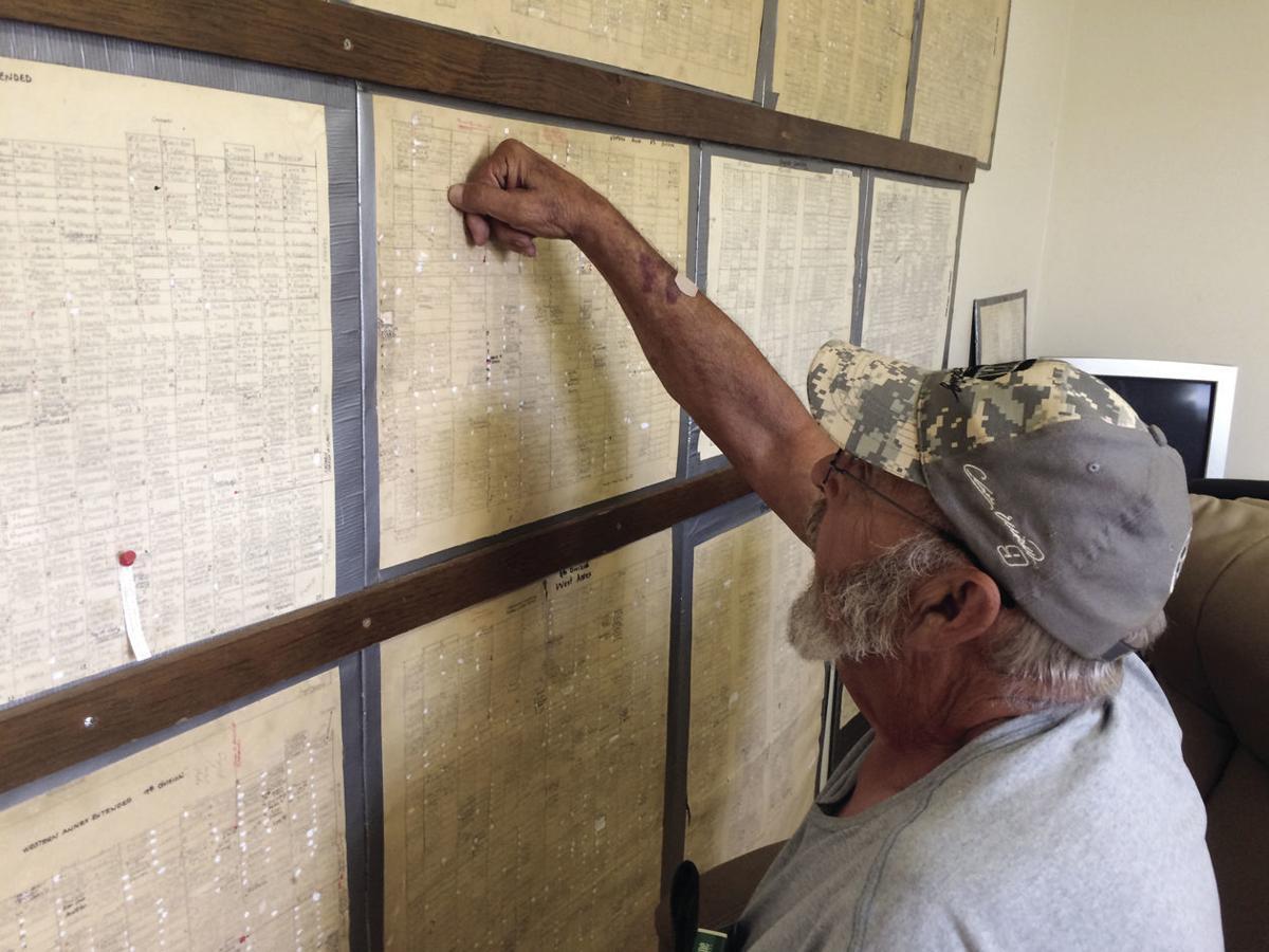 HH-3 Tom Landis looks at Graham cemetery chart.jpg