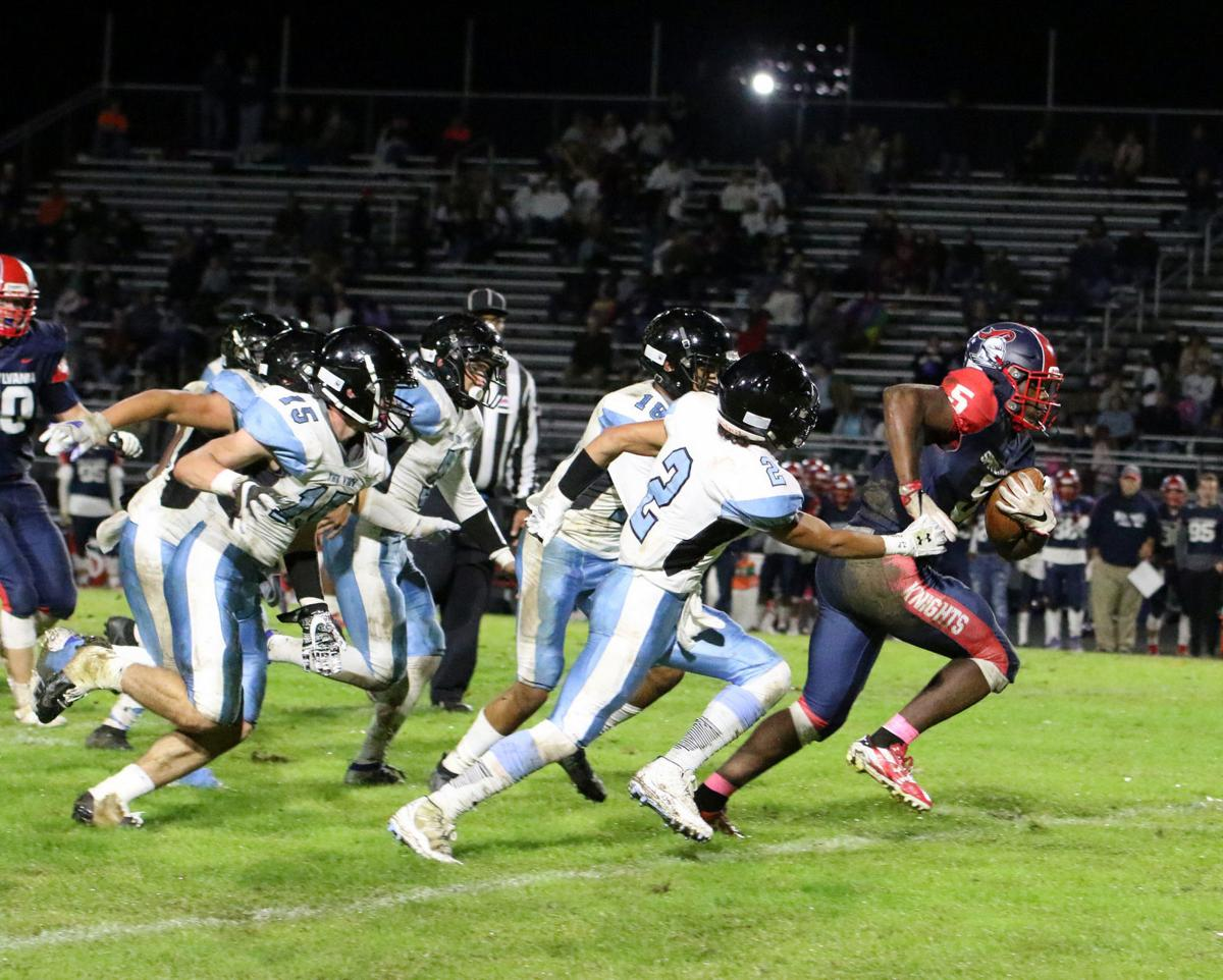 Spotsylvania's Ty-Shaun Colbert runs away from the Eastern View defense for some of his 168 rushing yards in Friday night's 18-14 victory.