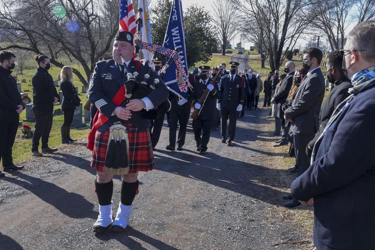 Procession led by bagpiper (copy)