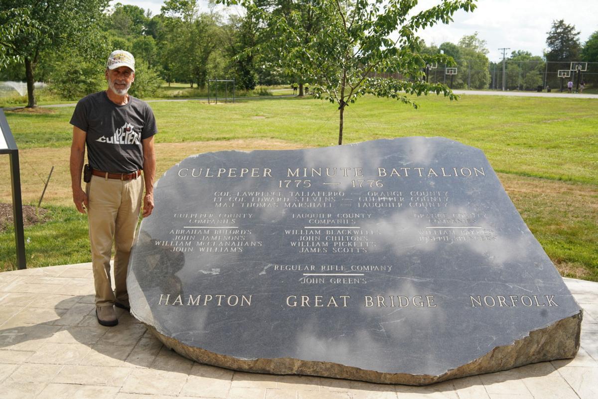Charles Jameson with Minutemen stone