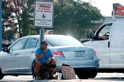 PHOTO panhandling sign