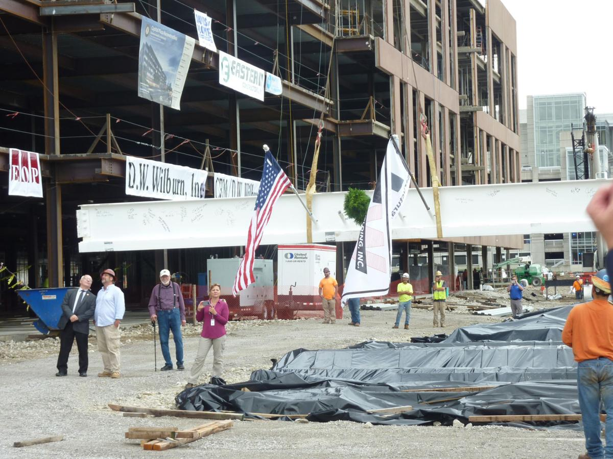 Beam me up: Officials, workers celebrate new state building progress