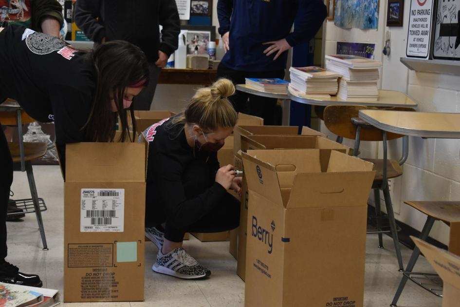 Franklin County French Club packs up books for school in Haiti