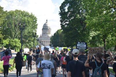 Protesters march from downtown to Capitol grounds to bring awareness to police brutality, racism