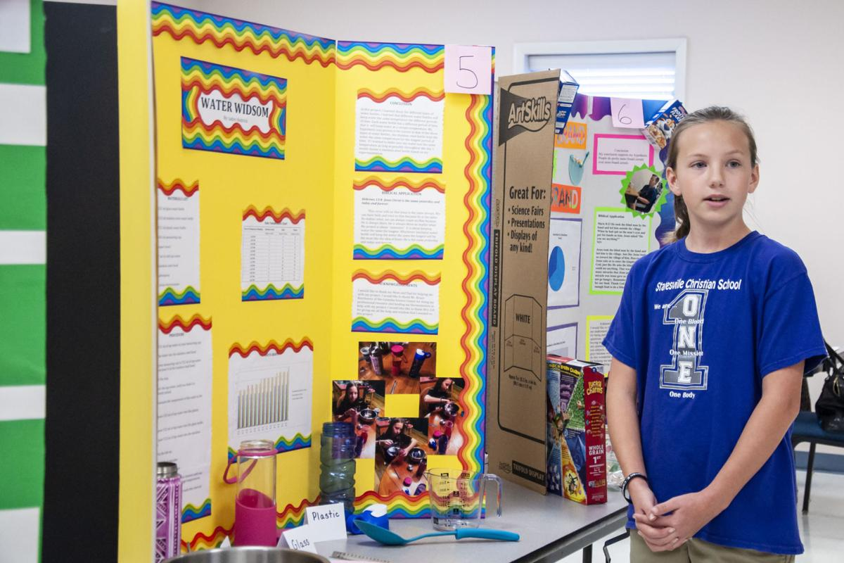 photos students present science projects at statesville christian