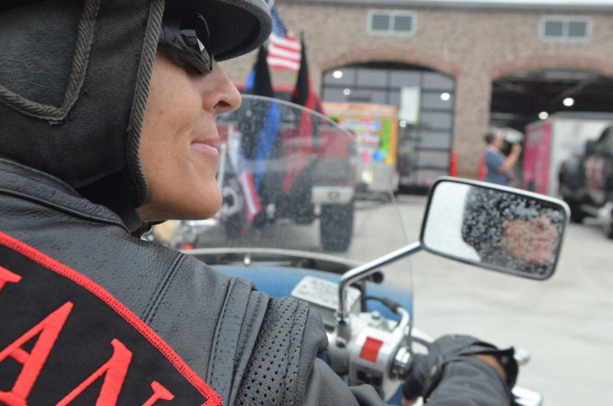 A rider waits to leave the Trinity Fire-Rescue Station in Statesville as part of the Red Knights NC Chapter 13's 5th Annual 9/11 ride.