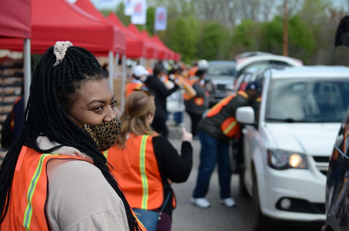 I-CARES Nerissa Morrison looks on after loading a vehicle at the Big Pop Up in Statesville on Thursday.