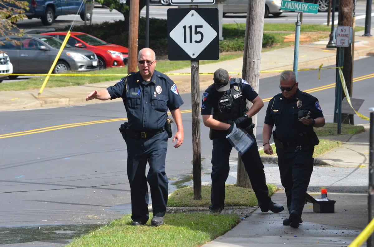 Members of the Statesville Police Department survey a crime scene on West Water Street in Statesville on Wednesday.