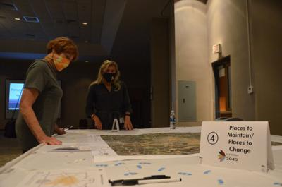 City of Statesville Planning Director Sherry Ashley talks to one of the vistors during the Land Development Plan Workshop at the Statesville Civic Center on Tuesday