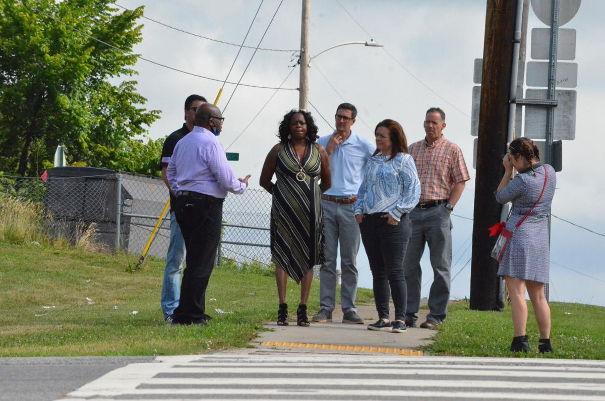 Brian Summers of the Sidewalk Institute, left, speaks to local leaders about the need for improvements to crosswalks on Garner Bagnal Boulevard in Statesville on Friday.